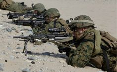 U.S. Marines from the 31st Marine Expeditionary Unit deployed from Okinawa, Japan, participate in a joint landing operation with the South Korean Marines on March 29 in Pohang, South Korea. South Korea has remained technically at war with North Korea since the end of the Korean War in 1953, and tensions on the peninsula are high once again as Pyongyang's new leader Kim Jong Un announced his administration will launch a satellite (which many analysts read as a ballistic missile test).