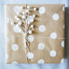 Get creative with your gift giving this season with some craft paper and paint! It's super cute and adds a more personal touch to your gifts