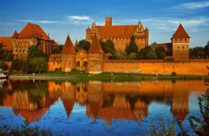 The Malbork Castle. It was built by the Teutonic knights and it is considered to be the largest castle in the world. The building was initially named Marienburg and so the town which grew around it. Just like Stari Most in Bosnia and Herzegovina, the Malbork castle was a victim of war. During World War 2, more than half of the castle was destroyed, but the building was mostly restored.