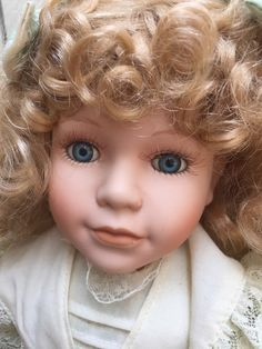 Victoria impex corp, porcelain doll, blonde, curly hair, blue eyes, gress, good condition