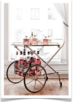 Bar Cart Ideas - There are some cool bar cart ideas which can be used to create a bar cart that suits your space. Having a bar cart offers lots of benefits. This bar cart can be used to turn your empty living room corner into the life of the party. Bar Cart Styling, Bar Cart Decor, Drinks Trolley, Bar Drinks, Pink Drinks, Bar Trolley, Cocktail Trolley, Pink Cocktails, Beverages