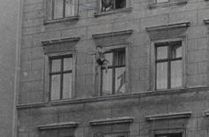 Rare Historical Photos - Four-year-old Michael Finder of East Germany is tossed by his father into a net held by firemen across the border in West Berlin, 1961