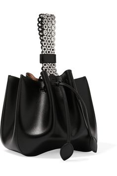 d32e07fb942f Alaïa - Bracelet eyelet-embellished leather bucket bag. Structured HandbagsAlaiaLeather  ...