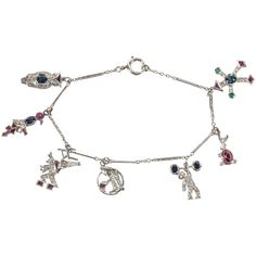 1920s Ruby Diamond platinum Charm Bracelet | From a unique collection of vintage charm bracelets at https://www.1stdibs.com/jewelry/bracelets/charm-bracelets/