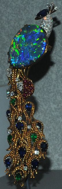...15cm peacock with opal, diamond and corundum ; features a 32 carat lightening ridge opal