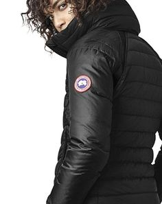 Canada Goose HyBridge hooded base jacket. Thermal Mapping technology for maximum warmth. Features lightweight and waterresistant semimatte finish. Tensileknit inserts at shoulders and underarms for flexibility. Packable hooded collar twoway zipper front. Long sleeves logo patch at left arm. Side zip pockets. Regular fit. Cropped at hip length. Nylon shell polyester lining. White duck down 750 fill. Machine wash. Made in Canada. Puffer Jackets, Winter Jackets, Canada Goose Women, White Ducks, Down Coat, Coats For Women, Underarm, Hoods, It Is Finished
