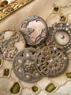 Fabulous collection of 5 antique 19th century metal buttons - mop, cut steel.  These buttons are so beautiful! mlr