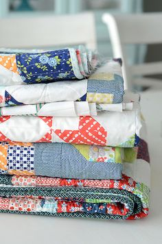 quilts in progress .The quilts are  from the new fabric collection Happy Go Lucky By Camille Roskelley. Beautiful fabric.