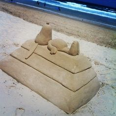 Sandcastles. Love snoopy!