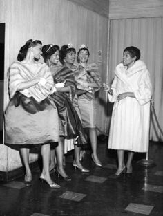 """from original pin: """"Singer Dinah Washington talks to a group of beauty queens."""" 1953"""