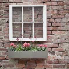 What to do with that old window lurking around your shed?   Set off & accent your planter box, of course.