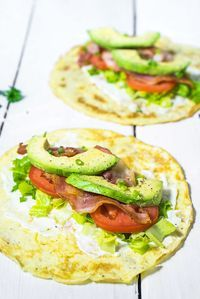 Save this low-carb breakfast recipes to make a healthy breakfast burrito with eggs, tomatoes, avocado + lettuce.