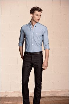 Cutting a lean shape, Janis Ancens wears a fitted shirt with dark wash denim jeans from BOSS Hugo Boss.