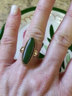 Check out this item in my Etsy shop https://www.etsy.com/listing/503958771/vintage-sterling-and-dark-green-jade