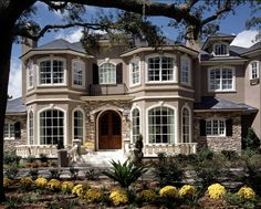 Two symmetrical turrets make this facade commanding, yet elegant in this large 6 bedroom home.  House Plan # 661293.