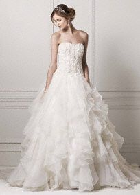 Completely stunning and over-the-top dramatic, this strapless Organza ruffled skirt wedding dress is truly magnificent! Strapless bodice features intricately desi... Learn more