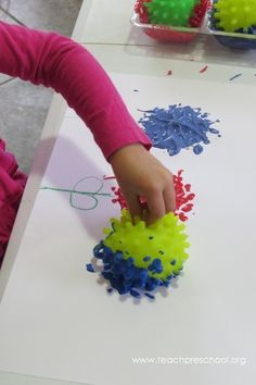 Bumpy Ball Painting by Teach Preschool