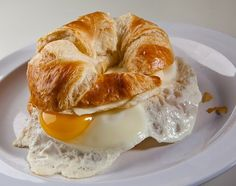 Our Croissant Egg & Cheese Sandwich is one of the breakfast items we serve all day! cafedeboston.com #breakfastallday #cateringboston