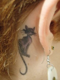 Small behind the ear tattoo