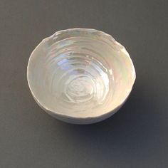 What a beautiful bowl! I love the iridescent look and the swirls...