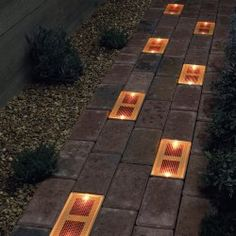 Solar LED brick are a great solution for your backyard or garden design - no cable, no electricity but great effect. see also http://saltolighting.com/homepage/product/149