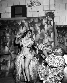 Performers at the Pacific Town Club, 1954. The Pacific Town Club was an African American men's social club located at the intersection of Adams Blvd. and Montclair Ave. in Los Angeles. Henry Adams Collection.   Institute for Arts and Media Photographs.