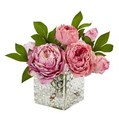Nearly Natural Peony in Glass Vase Layers of pink toned petals mix with deep green foliage for a full bloom arrangement. Paired with an elegant, textured glass vase to draw the eye in. Place in a powder room or as a centerpiece in a dining room.