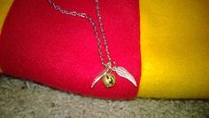 snitch necklace by BadWolf314