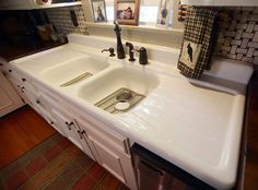 White Wooden Storage Cabinet With Double Cast Iron Sink And Drainboard Combined Unique Faucet, Adorable Cast Iron Kitchen Sinks Design Ideas: Interior, Kitchen