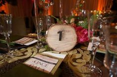 Last year, the National Association for Catering and Events hosted its annual fund-raising gala at the Liaison in Washington, where design elements drew inspiration from classic fairy tales. To add an enchanted-forest feel to the dining table centerpieces, table numbers were spray painted on wood slabs.
