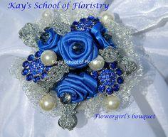 Blue Brooch Flowergirl's wand with handmade satin Roses Satin Roses, Brooch Bouquets, Titanic, Wands, Handmade, Wedding Ideas, Facebook, School, Hand Made