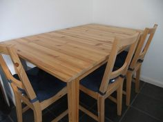 Extendable IKEA Solid Wood Table With Four Chairs