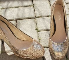 1. Cover shoes with fabric glue 2. Cover generously with glitter 3. Stand for 5 minutes 4. Cover with thick coat of clear coat, let dry well and repeat 5. Wear your lovely new creations!