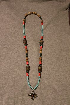 Necklace with Picture Stone beads, green glass beads, red wooden beads, Turquoise beads & Turquoise Mala beads, Yak Bone beads & a Dorje Cross. 35 €