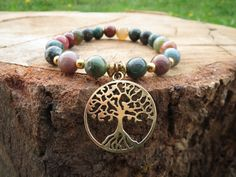 Check out this item in my Etsy shop https://www.etsy.com/listing/231738163/tree-of-life-charm-bracelet-indian-agate