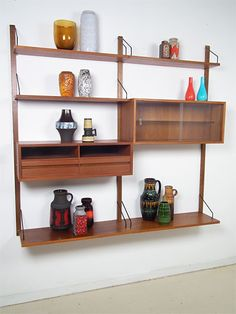 """Very nice wall system """"Royal"""" by Cado. Designed by Poul Cadovius in the fifties.  #vintage #cadovius"""