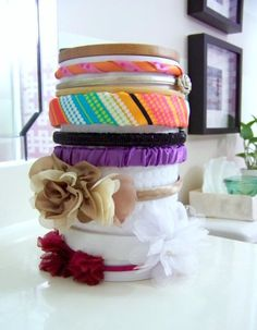 Headband Organizer.  All you need is a roll of Papertowel and some fabric.  Decorate the top with a ribbon or bow if you like.