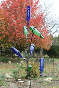 bottle tree that can hold unopened bottles! I want this in my dining room!