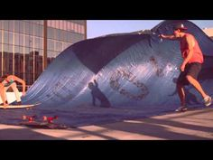 INVISIBLE CHILDREN: We work really hard, and play sorta hard. Mainly we work. But when we discovered tarp surfing.