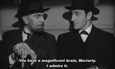 "Basil Rathbone as Sherlock Holmes and George Zucco as Professor Moriarty in The Adventures of Sherlock Holmes (1939). "" """