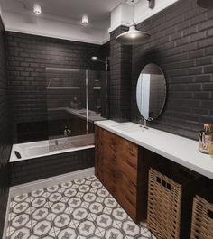 płytka cegielka w czarnym kolorze,modne płytki cegiełki na ścianę,czarna glazura w łazience,aranzacja czarnej łazienki,szafki z akacjowego drewna,łazienkowe dekoracje i dodatki,okragłe czarne lustro,industrialne kinkiety w łazience,etniczna terakota w łazience,modne wzory płytek na podłogę w łazience,czarno-biała łazienka w stylu mieszanym z industrialnymi akcentami,plecione kosze brązowe i szare,wyplatane pojemniki do łazienek