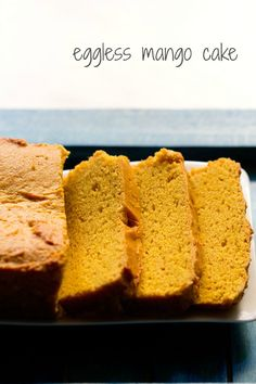 eggless mango cake recipe with step by step photos. easy eggless mango cake recipe made with whole wheat flour/atta, fresh mangoes, butter, condensed milk.