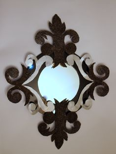 La Fleur mirror, sheet metal, powder coated.