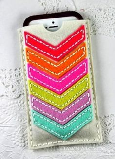 This mobile phone accessories case is handmade from 100% wool felt and features a colorful chevron design.