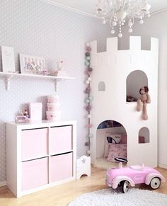 Pink fantasy little girl's room with a castle tower for reading and storage.