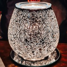 Crushed, silver-plated glass adds brilliance to a timeless mosaic pattern. To create the look, the warmer body is rolled onto a sheet of broken glass, ensuring no two patterns are exactly alike. Body Warmer, Broken Glass, Cozy Corner, Mosaic Patterns, Girls Best Friend, Fragrances, Silver Plate, Crushes, Vase