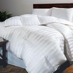 Add warmth and classic appeal to your bedroom with this timeless Siberian white down comforter. Amazing 500-thread count cotton provides quality and luxury that you have to feel to believe. Cozy down insulates you against even the chilliest nights.