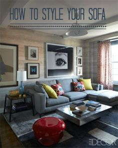 Lots of ideas and tips on how to Style your Sofa to give it the wow factor!  Like the ottoman and coffee table placement in this pic