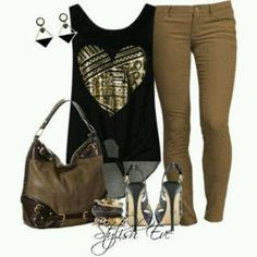Black tank top with gold heart on front beige pants and and purse and black and gols shoes