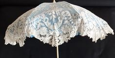 a very fine 19th century Point de Gaze lace, ivory, gold coloured metal, and turquoise stones parasol with folding handle.  ANTIQUE LACE Joachim